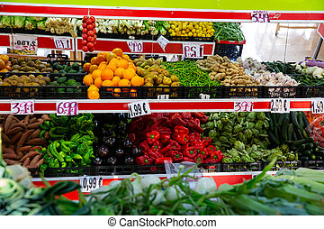 Shelves with variety testy vitamin products in fruit and ...