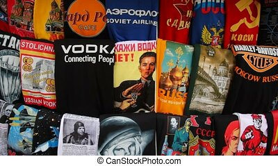 Shelving russian T-shirts with symbols of country in kiosk...
