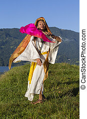 Shemale Sirena Sabiha dancing with a fan at dawn in Pokhara, Nepal.  was born in the Philippines