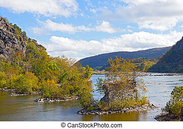 Shenandoah River with old bridge remains in Harpers Ferry, West Virginia, USA.