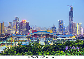 Shenzhen, China city skyline at twilight in the Civic Center...