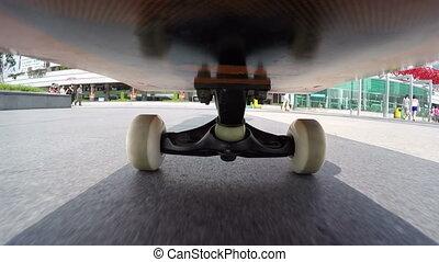 riding skateboard on street - Shenzhen, China - July 19, ...