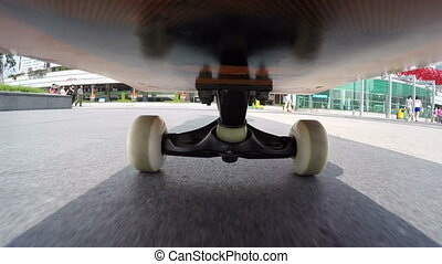 riding skateboard on street - Shenzhen,China - July 19,...