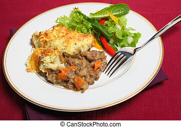 Shepherd's pie meal on cloth - Close-up view of a meal of ...