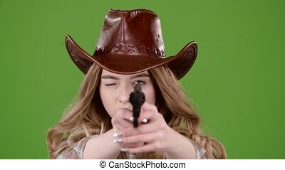 Sheriff girl raises her head and takes a shot from the...