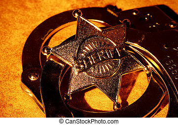 Sheriffs Badge and Handcuffs