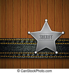 Sheriff's badge with denim element on a wooden background.