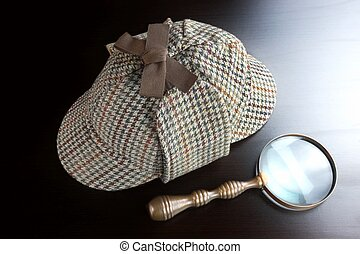 Sherlock Deerstalker Hat,   And Vintage  Magnifying Glass On Black Table