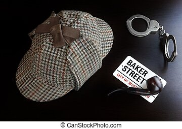 Sherlock Deerstalker Hat,  Handcuffs And Smoking Pipe On Black Table
