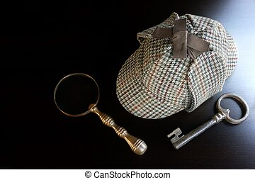 Sherlock Deerstalker Hat,  Key And Magnifier On Black Table Background