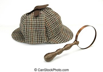 Sherlock Holmes Deerstalker Cap And Vintage Magnifying Glass Isolated