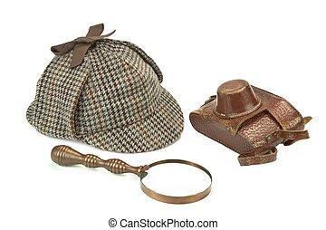Sherlock Holmes Deerstalker Cap, Vintage Magnifying Glass And Retro Camera