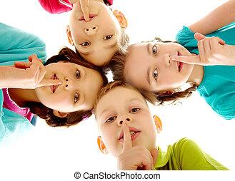 Group of children fingers on lips making silence