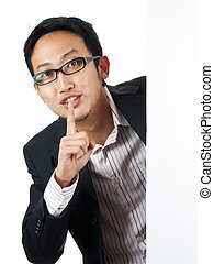 Shhh... - Asian man with blank board, finger on lips