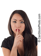 Shhh - Studio shot of beautiful sexy young asian woman with finger to lips