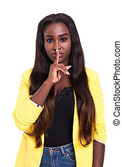 Shhhh! Silence please! - Beautiful african young woman...