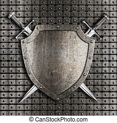 Shield and two swords crossed hanging on metal wall with ...