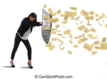 Shield spam - Businesswoman is protected with shield by...