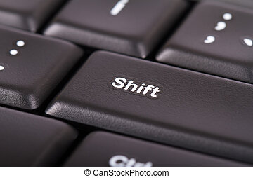 Shift Button - Close up view of shift button on black...