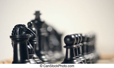 Shifting focus on chess - A clip of black pieces on a...