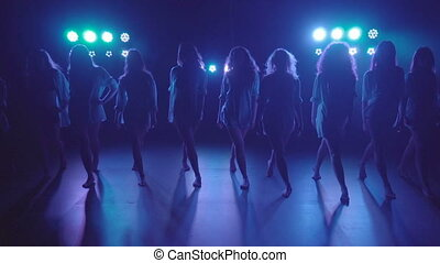 Shilouettes of female dancers group