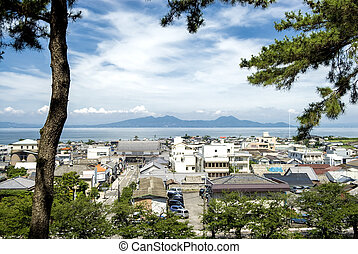 Shimabara city and sea viewed from the between the pine...