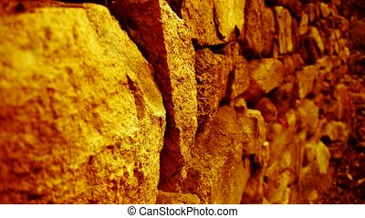 shine golden sunlight on stone wall in mountain.