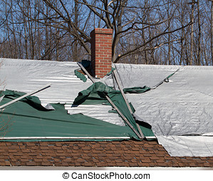 Shingled Roof Damage - Shingle roof covered with plastic...