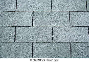 A close shot of roofing shingles.