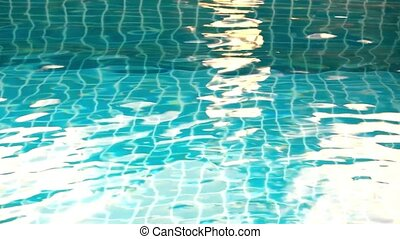 Shining blue water ripple in pool at sunset time. Video shift motion