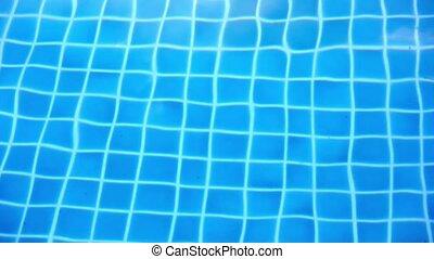 Shining blue water ripple in pool