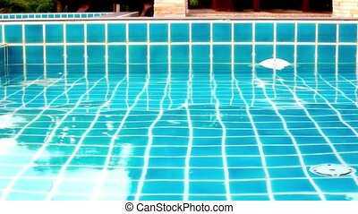 Shining blue water ripple in pool. Video shift motion