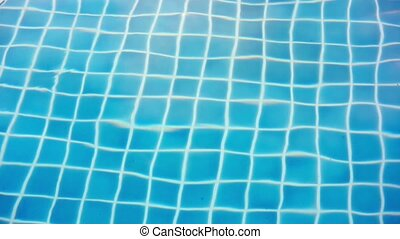Shining blue water ripple in pool