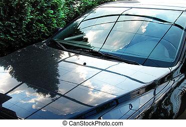 Shining car - shining car surface, clouds and sky reflection