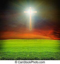 shining cross over dark sky and field