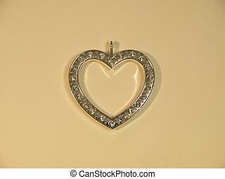 Shining diamonds heart on a cream background