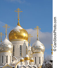 Shining domes of white church