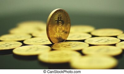 Shining golden bitcoins in close-up - Close-up view of...