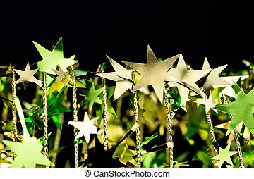 Shining golden Christmas stars on black background