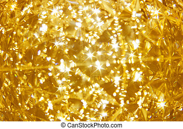 Shining golden mosaic glass background, brilliance of crystal golden