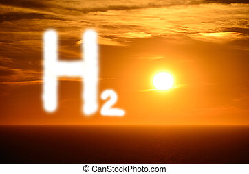 shining h2 hydrogen letters with bright orange sunset at the sea