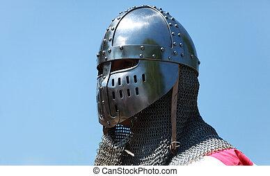 Image of a templar knight helmet against a blue sky. Natural lighting.