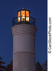 Robert H. Manning Lighthouse in Empire, Michigan shines in the darkness