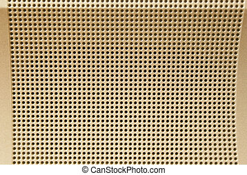 Shining metallic light golden perforated background