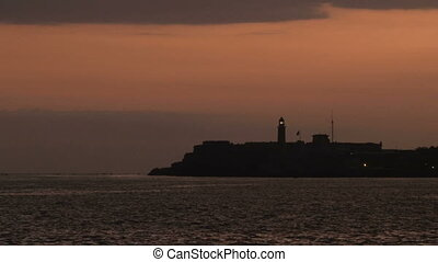 Shining Morro - Siluette of Morro castle lighthouse...