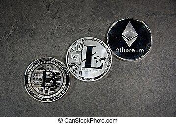 BTC LTC ETH Bitcoin Litecoin Ethereum coins - Shining silver...