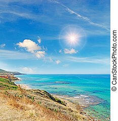 panoramic view of Lu Bagnu coastline on a sunny day