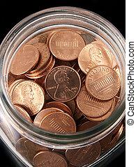 Shinny Penny Jar - Tight shot of shinny pennies in a vintage...