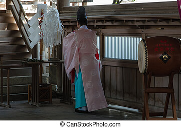 Shinto Priest praying at Atago Temple Fukuoka, Japan