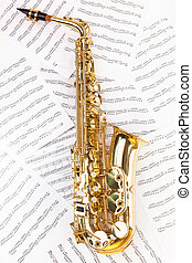 Shiny alto saxophone in full size on musical notes - Shiny...